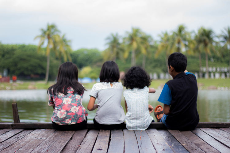 Kids in the Park Adult Child Cultures Day Education Family Females Friendship Girls Group Of People Junior High Kids Kidsphotography Offspring Outdoors People Rear View School Children Sitting Student Togetherness