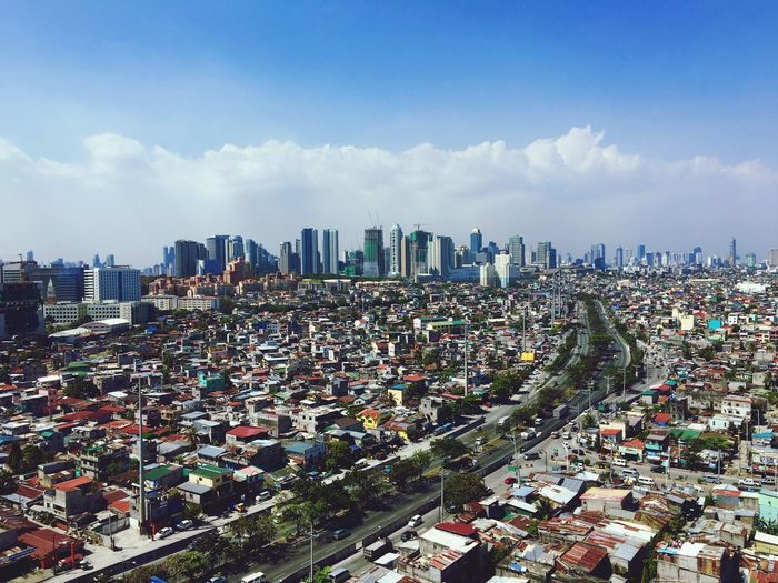 A view of Taguig and Makati is seen from above a building in Taguig, Metro Manila. Building Exterior Architecture City Cityscape Built Structure Crowded High Angle View Sky Outdoors Residential Building Skyscraper Travel Destinations Day Urban Skyline Philippines Makati Taguig Makati City Aerial View Top View Bird's Eye View