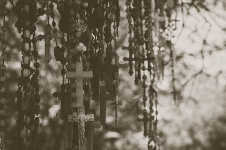 Close-up of cross on cemetery