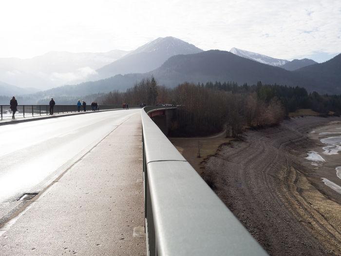 Empty road against mountain range