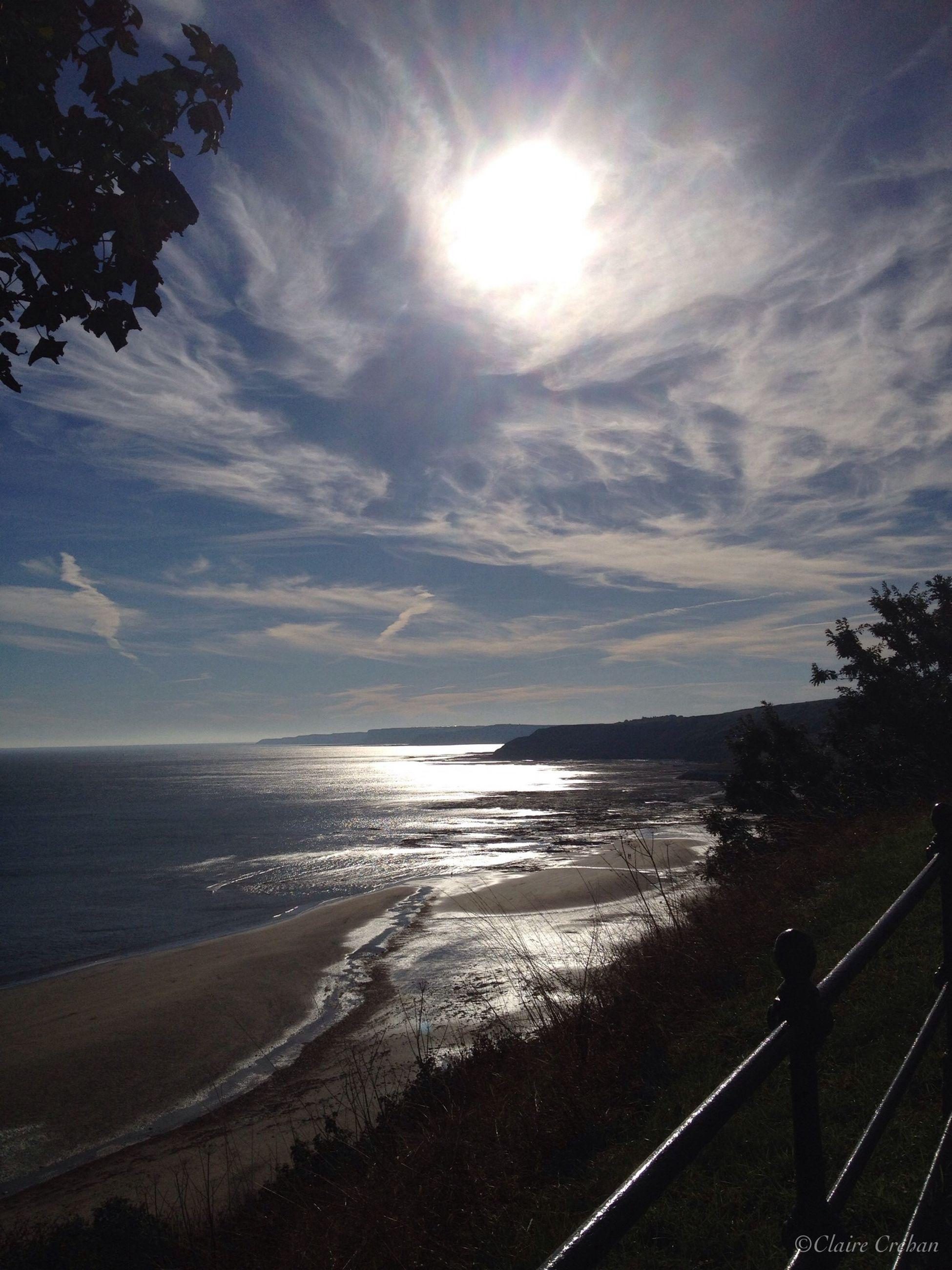 water, sea, tranquil scene, tranquility, sky, scenics, horizon over water, sun, beauty in nature, beach, sunlight, nature, cloud - sky, reflection, shore, sunbeam, idyllic, sunset, cloud, outdoors