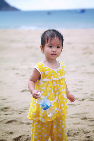Asian baby girl on the beach Beach Beauty In Nature Childhood Cute Day Focus On Foreground Front View Girls Horizon Over Water Leisure Activity Looking At Camera Nature One Person Outdoors Portrait Real People Sand Sand Pail And Shovel Sea Shore Sky Standing The Portraitist - 2017 EyeEm Awards Vacations Water