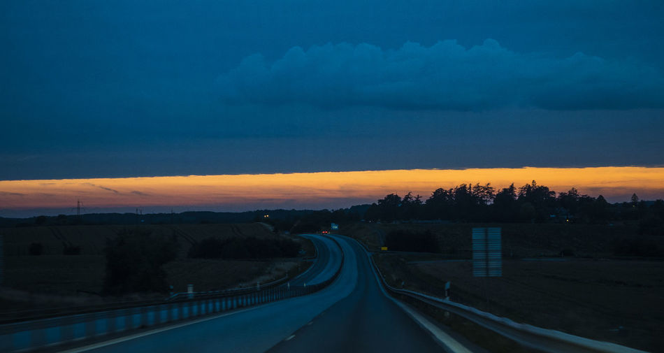 yellow Sky Road Sunset Transportation Cloud - Sky Nature No People The Way Forward Direction Beauty In Nature Scenics - Nature Dusk Environment Tranquil Scene Landscape Tranquility Tree City Outdoors Dramatic Sky