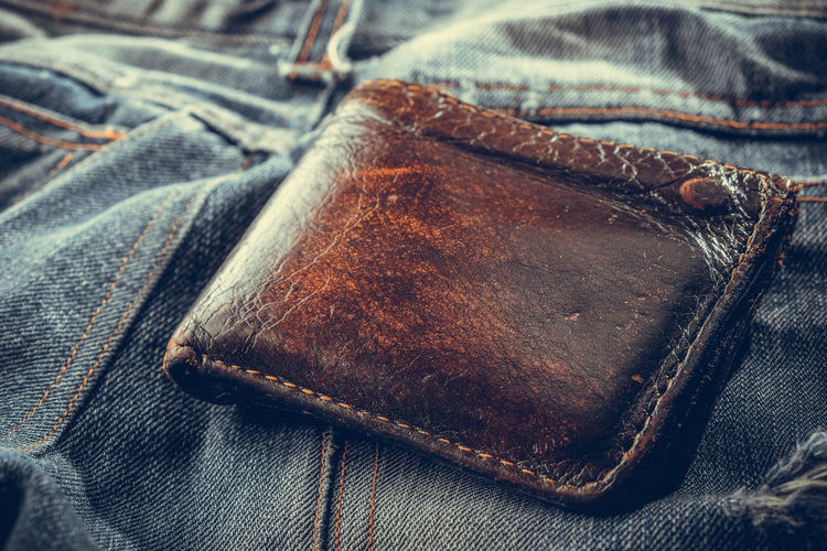 Close-up of wallet on denim