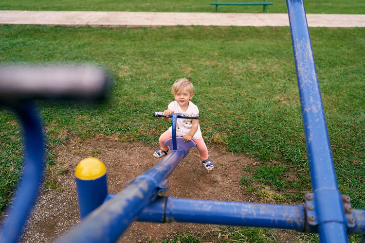 Full length of girl playing on playground