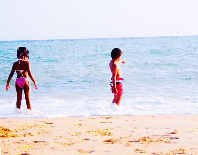 Boy and girl looking at the ocean Kid Summer ☀ Children People Boy And Girl The Great Outdoors With Adobe Nature Beach Nature Photography Family Boy And Girl Holidays African People Of The Oceans