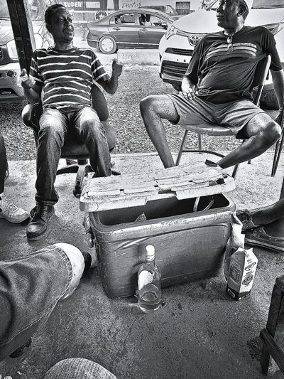 Real People Outdoors Lifestyles Drink Men Celebration Hanging Out Hanging Colón City Panama Canal Panamanian People_bw Panamá Panama City People Talking Friendship Brotherhood Neighbourhood Adult Day Moonshine Moonshine And Milk Milk Streetphotography