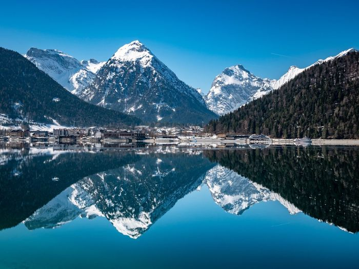 EyeEm Selects Mountain Water Snow Scenics - Nature Winter Reflection Lake Mountain Range Beauty In Nature Cold Temperature Tranquility Tranquil Scene Snowcapped Mountain Waterfront Nature Blue Symmetry Outdoors Sky No People