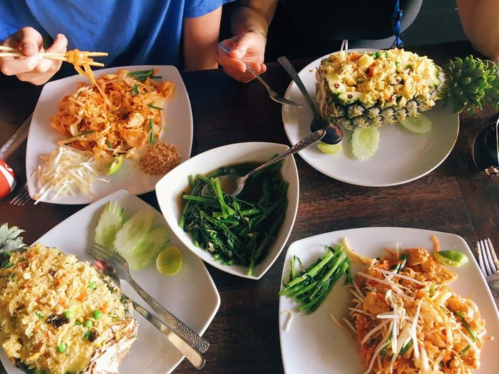 High angle view of thai food served on table
