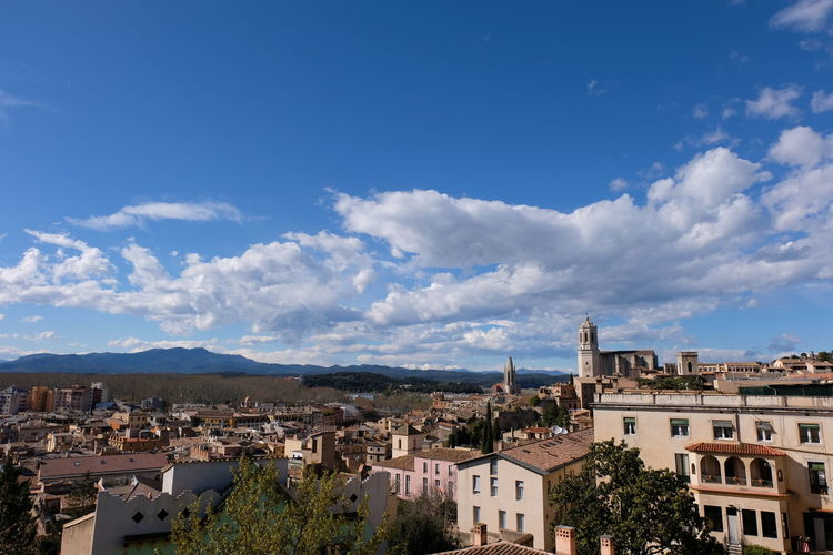 Girona Architecture Blue Building Building Exterior Built Structure City Cityscape Cloud - Sky Day High Angle View House Nature No People Outdoors Plant Residential District Row House Settlement Sky Town TOWNSCAPE Tree