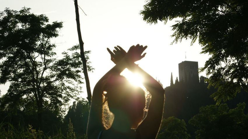 Dance keep us alive! EyeEm Best Shots EyeEm Selects EyeEmNewHere Art And Craft Back Lit Day Growth Human Representation Lens Flare Low Angle View Nature One Person Outdoors Plant Representation Sculpture Silhouette Sky Sun Sunlight Tree