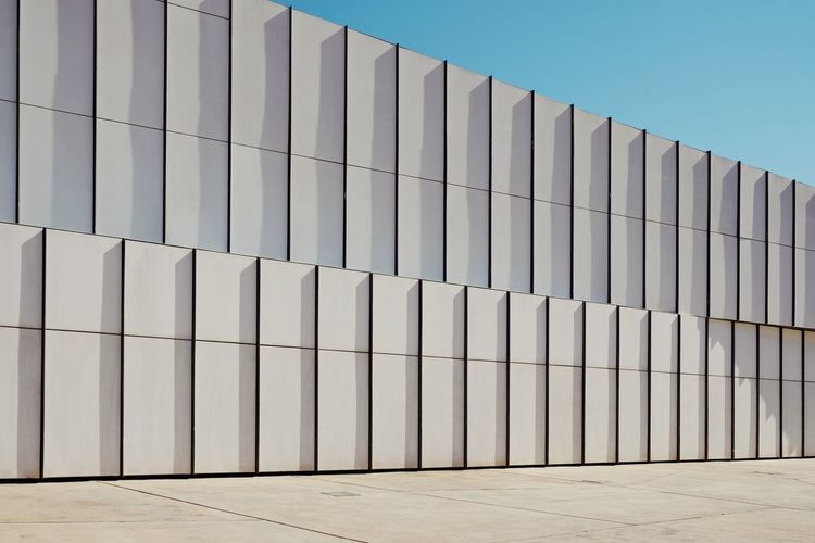 Architecture Built Structure Building Exterior Building Sky Day Clear Sky No People Pattern Outdoors Sunlight Wall - Building Feature In A Row Industry Blue Repetition City Low Angle View Minimalism Minimal Minimalist Architecture Architecture_collection Capture Tomorrow 17.62°