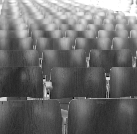 Row of conference chairs in black and white