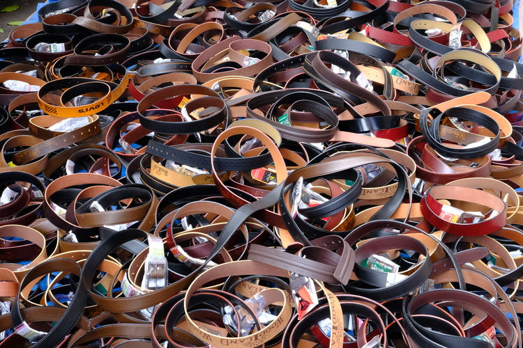 Belts in the market Leather M Market Sale Abundance Backgrounds Belt  Belt,belts, Circle,circles,leath Belts Belts And Pulleys Close-up Clothes Clothing Day Fastening Fastenings Indoors  Large Group Of Objects Market Stall Marketplace Multi Colored No People Pattern Selling On The Street Stall