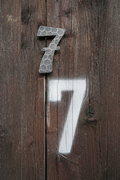 7 times 11 Eleven Seven Sisters Brown Close-up Communication Day Door Entrance Metal No People Number Old Plank Table Text Textured  Wall - Building Feature Wood Wood - Material Wood Grain