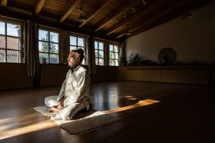 Woman sitting on wooden floor