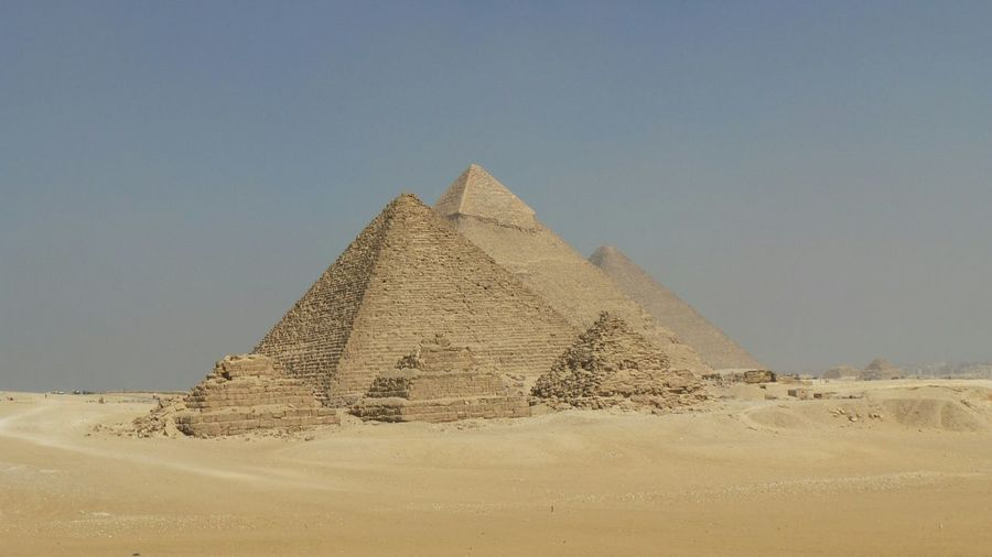 Giza pyramids at desert against clear sky