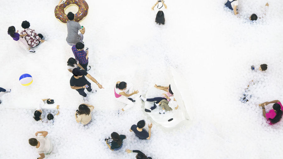 High angle view of people playing in snow