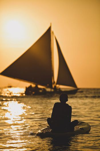 Priceless EyeEm Best Shots Philippines EyeEm Selects The Week on EyeEm Editor's Picks Enjoying Life Naturephotography Sailboat Waiting EyeEm Gallery EyeEm Seashore Paddleboarding EyeEm Nature Lover Sunset Water Sky One Person Sea Rear View Leisure Activity Silhouette Real People Reflection Beauty In Nature Beach Vacations Orange Color Nature Lifestyles Travel Destinations