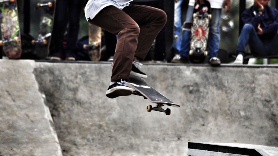 Low Section Of Man Skateboarding At Playground