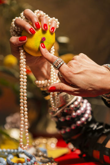 Gestures of a woman with jewelry, pearls, fruits and flowers. Abundance Wealth Celebration Art And Craft Mood Jewelry Gold Pearls Gesture Luxury Hand One Person Human Hand Holding Focus On Foreground Human Body Part Adult Belief Bracelet Women Selective Focus Real People Religion Spirituality Close-up Bangle Indoors  Nail Finger The Foodie - 2019 EyeEm Awards