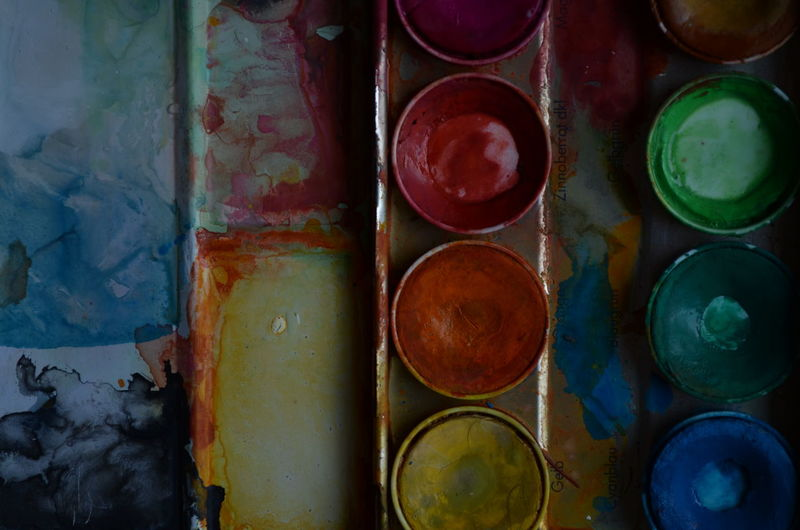 Directly Above Shot Of Watercolors In Messy Palette