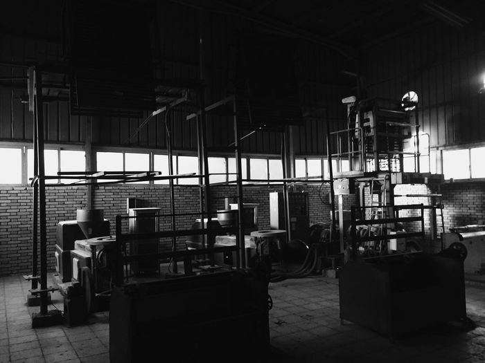 Light And Shadow Light Window Architecture Machines Steel An Abandoned Place Indoors  Industry Factory Architecture No People Built Structure Warehouse Day Metal Building Machinery Architectural Column Industrial Building  Industrial Equipment Business