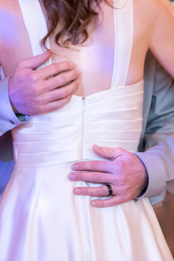 Bride and Groom's First Dance Back View Dance Dancing Husband Love Loving Man Rear View Relationship Woman Adult Celebration Dress Event Holding Human Hand Marriage  Midsection Real People Touching Wedding Wife