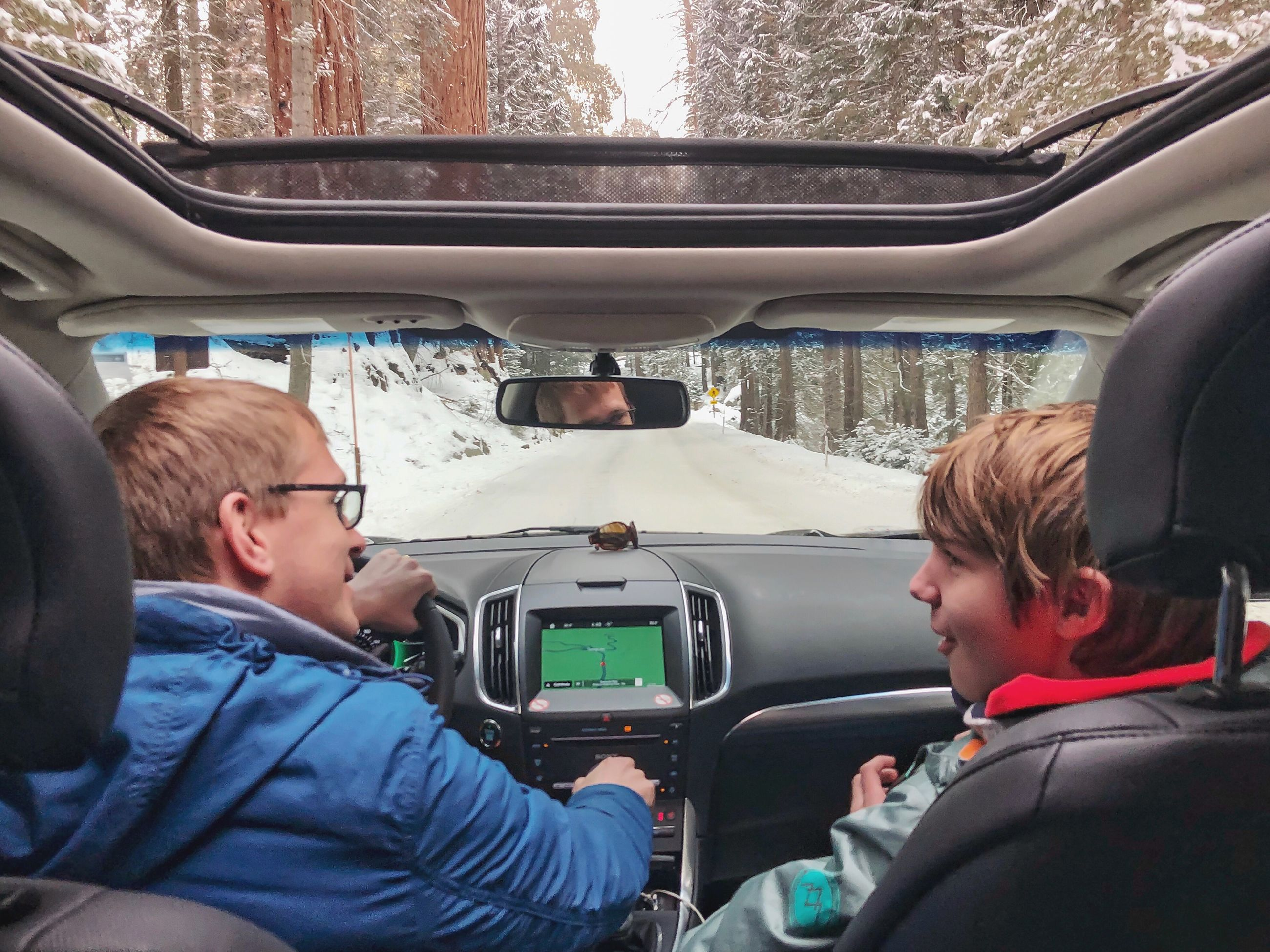 mode of transportation, men, transportation, vehicle interior, real people, car, males, two people, sitting, travel, land vehicle, boys, togetherness, motor vehicle, portrait, car interior, child, childhood, glass - material