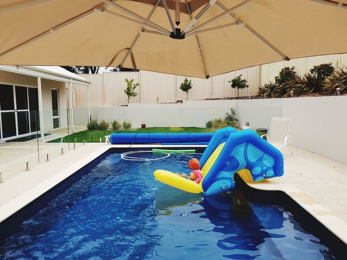 Pool Shades Beauty In Nature Colours Garden Photography Backyardphotography Summetime Myhome Architecture Garden Decoration Celebration Pool Fence Glass Fences Umbrella Pool Umbrellas Water Swimming Pool Blue Water Slide Pool Raft Inflatable  Float