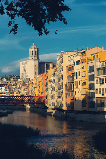 Building Exterior Built Structure Architecture Sky Water Building City Nature Residential District Waterfront Reflection Cloud - Sky No People River Outdoors Tree Mode Of Transportation Bridge - Man Made Structure Old Buildings Blue Sky Sunlight And Shadow Catalunya Warm Colors