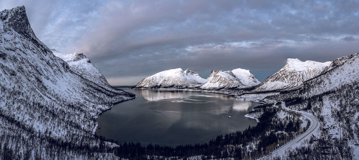Scenic view of fiord against sky during winter