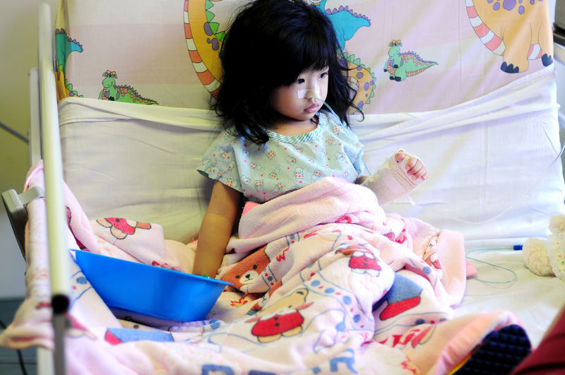 hospitalized Hospital Medical Condition Ward Casual Clothing Child Childhood Children Ward Females Front View Illness Indoors  Innocence One Person Real People Sitting The Portraitist - 2018 EyeEm Awards The Photojournalist - 2018 EyeEm Awards