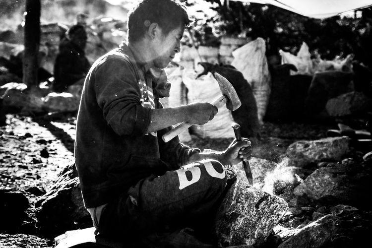 Man working on rock