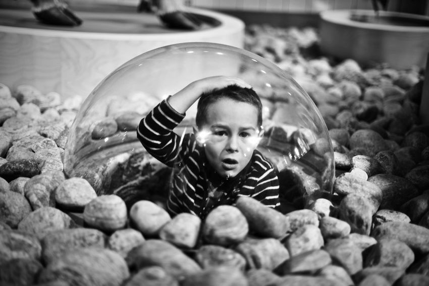 Boy in a bubble Kids Being Kids Quirky Surprised Blackandwhite Boy Boy In A Bubble Confused Exploration Expression Indoors  Museum One Person Rocks Shocked Face Space Be. Ready. EyeEmNewHere Be. Ready. EyeEmNewHere