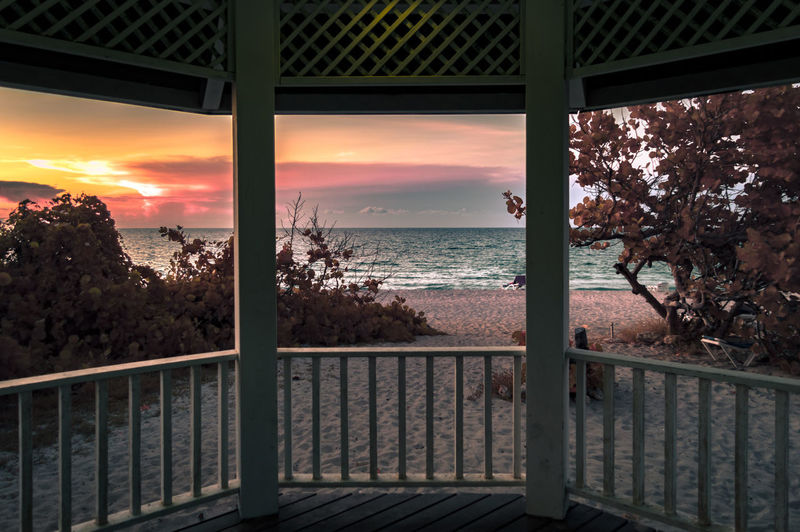 Sunset View From The Pavilion [FS] Architecture Beautiful Check This Out EyeEm Best Shots Hanging Out Hello World Nature Plant Relaxing Taking Photos Tranquility Tree Vacations Beach Beauty In Nature Enjoying Life First Eyeem Photo Landscape No People Outdoors Scenics Sea Sky Sunset Water