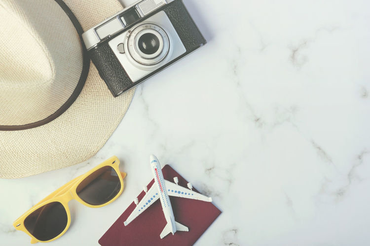 Camera - Photographic Equipment Still Life Retro Styled Digital Camera Sunglasses Vacations Holidays Travel Travel Destinations Traveling Trip Plane Destination Adventure Tourism Tourism Destination Holiday Tourist Summer Summertime Concept Transportation Planning Lifestyle Beach Passport Happiness Excursion Hat Vintage Space Object Flat Accessories