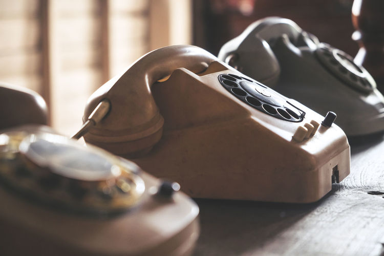 Close-up of vintage telephones on table