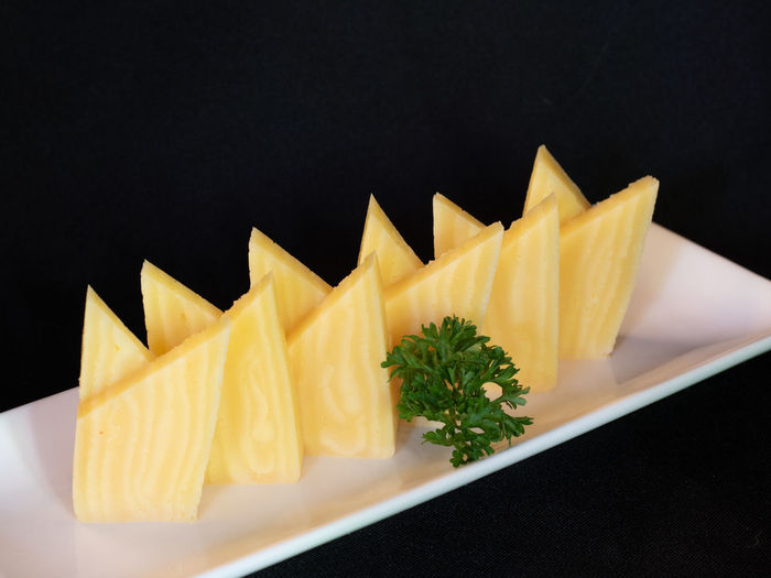High angle view of chopped fruits on table against black background