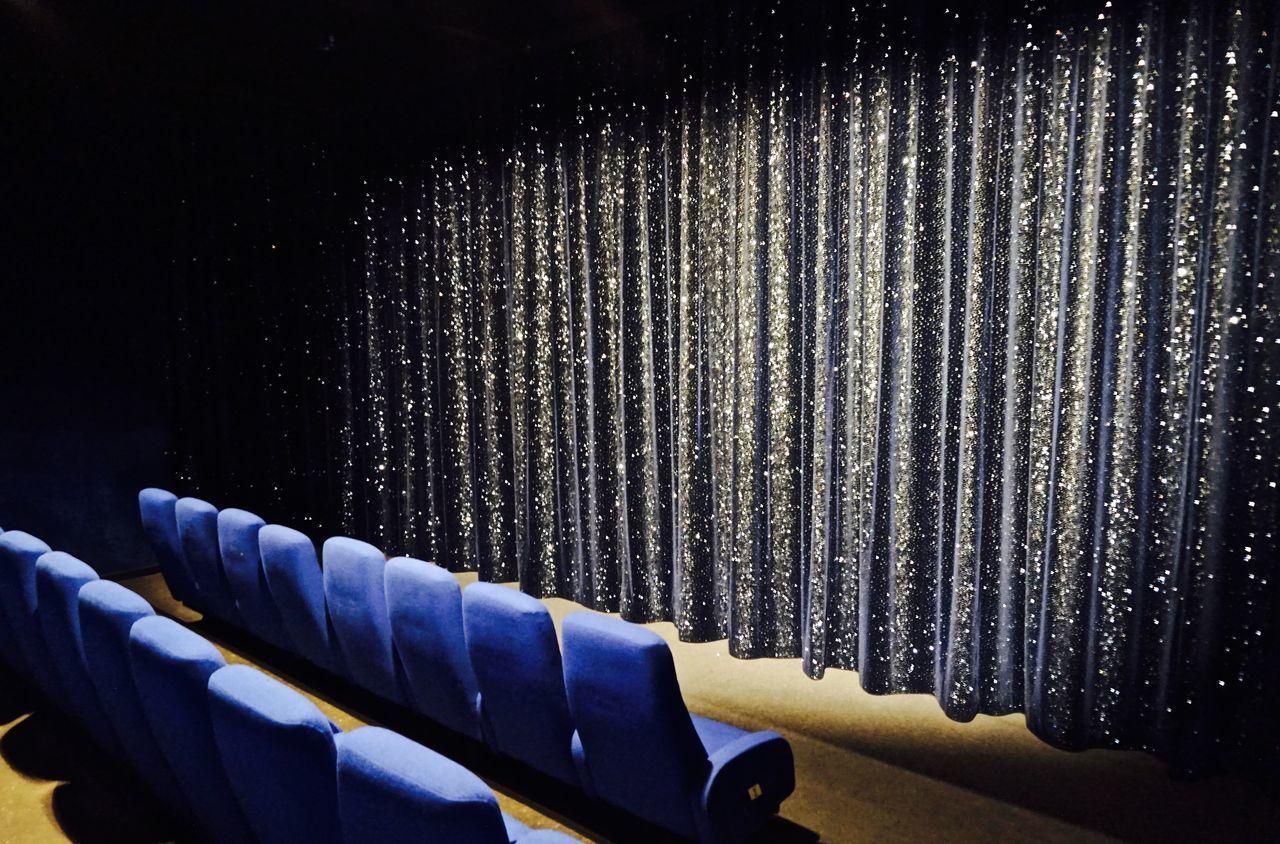 Empty blue seats at auditorium