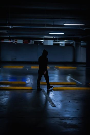 Full length of man walking in parking lot