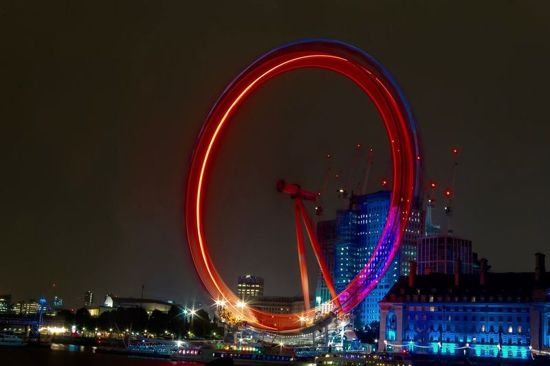 Turning 24/7 London Eye London Canon City Cityscape Illuminated Ferris Wheel Nightlife Multi Colored Amusement Park Ride Red Water Arts Culture And Entertainment Light Painting Entertainment Long Exposure