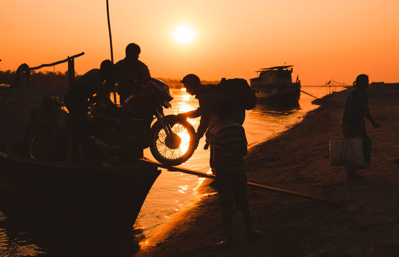 transporting a bike to the other end of the river ... Sunset Sky Orange Color Water Transportation Mode Of Transportation Real People Men Group Of People Silhouette Nature Sun Sea Lifestyles Beauty In Nature People Nautical Vessel Leisure Activity Standing Outdoors Life Brahma Assam Tinsukia Storytelling Travel Destinations Travel Rural Scene Rural Motor Vehicle Bike The Photojournalist - 2019 EyeEm Awards The Traveler - 2019 EyeEm Awards