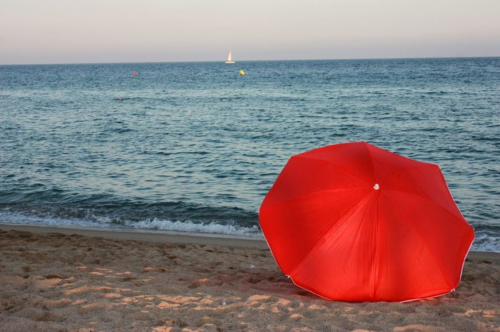 Umbrella Beach Horizon Over Water Sea Water Vibrant Color Nature Clear Sky Tranquility Red Dusk Sky Boat Sand And Sea Seaside Peace And Quiet Peaceandquiet Outdoors Sunset Sunset_collection