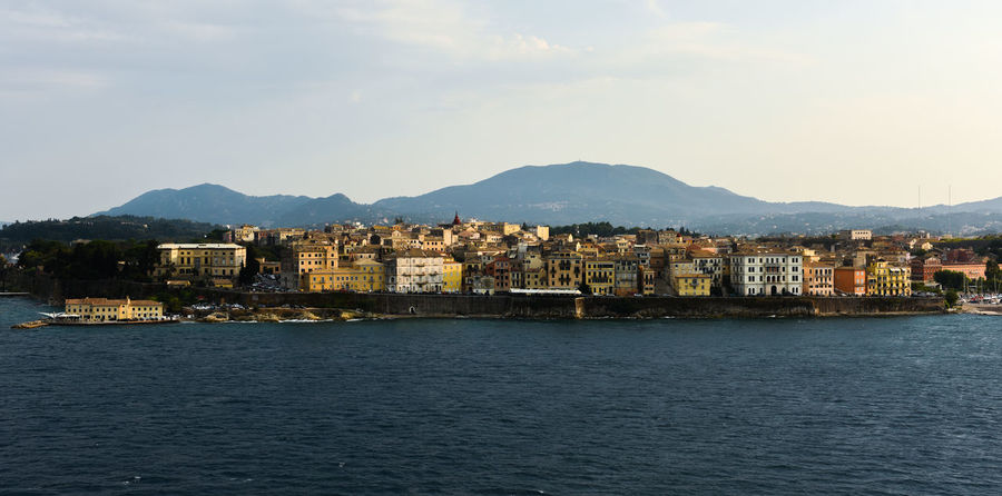 CORFU ISLAND Holiday Architecture Building Exterior Built Structure Corfu Corfu City Day Go-west-photography.com Greece Ionian Islands Ionian Sea Mountain Mountain Range Nature No People Outdoors Residential Building Sky Summer Town Travel Destinations View Into Land Water Waterfront