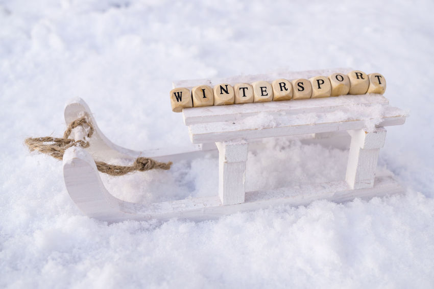 Activities Sledge Sleigh Text Winter Wintersport Aktiv Close-up Communication Day Leisure Nature No People Outdoors Outdoors Photograpghy  Sky Snow Sports Symbol Text Winter Wooden Cubes Words