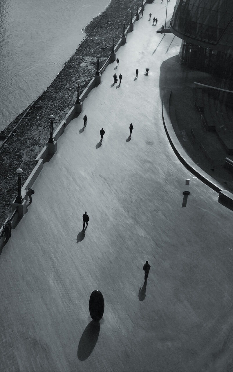 High Angle View Of Silhouette People On Street