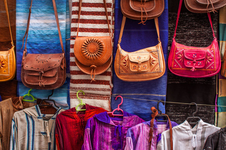 Purses hanging in store for sale at market