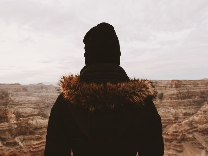 Rear View Of Man At Grand Canyon National Park Against Sky