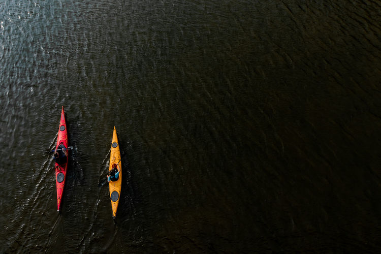 High angle view of people on boat in water